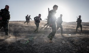 Peshmerga fighters advance on Islamic State positions on the outskirts of Mosul