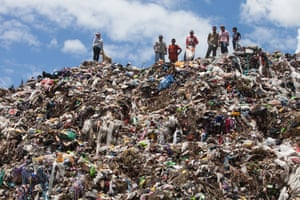 Rubbish pickers stand on a rubbish dump on the outskirts of San Pedro Sula