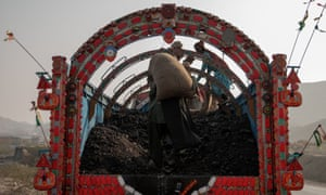 Sacks of coals being loaded on to a truck in Mach, Balochistan.