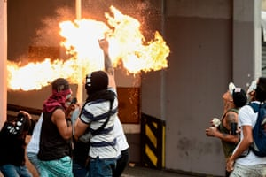 Petrol bombs are used by opposition demonstrators