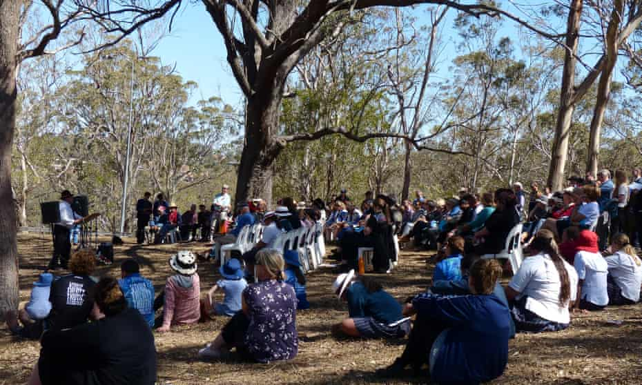 People gather on the hill at the edge of Toowoomba to commemorate the One Tree Hill battle