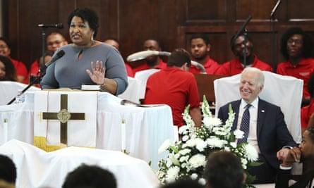 Abrams speaks at Brown Chapel African Methodist Episcopal Church in Selma, as Joe Biden looks on.