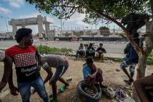 East African migrants gather at former football stadium in Aden
