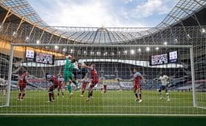 West Ham goalkeeper Lukas Fabianski clears the ball after a Spurs corner.