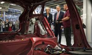 Theresa May and Philip Hammond at Jaguar Land Rover's Solihull plant in September 2016.