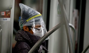 A subway passenger wears a face mask among other protective items in Shanghai