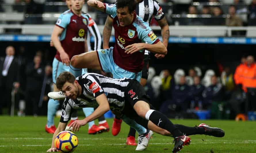Burnley's Jack Cork is sent sprawling by Paul Dummett of Newcastle United but no penalty was given.