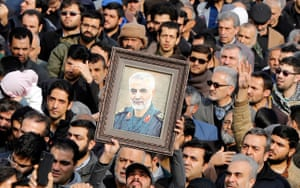 Thousands of Iranians in Tehran take to the streets to mourn the death of Soleimani
