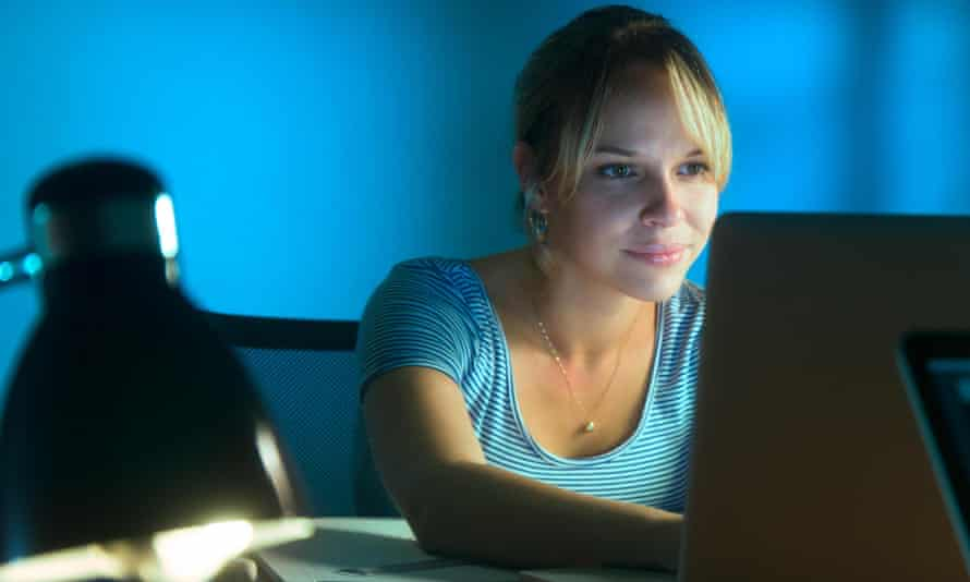 Beautiful woman working late at night