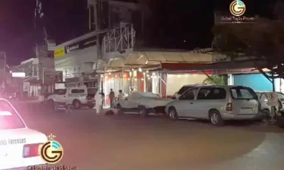 Emergency officials stand outside a bar after gunmen shot dead a journalist early on Sunday in the Mexican city of Iguala in the south-western state of Guerrero on Sunday.