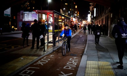 Cyclists in a designated bike lane in Manchester city centre.