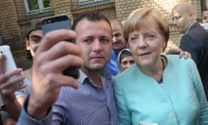 Angela Merkel posing for a selfie