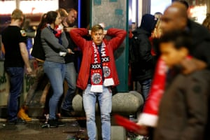 An Ajax fan looks dejected after the match.