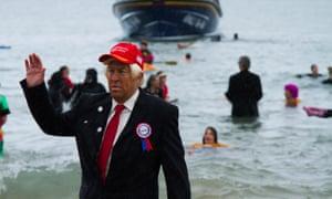 Man dressed at Donald Trump at Tenby annual Boxing Day swim.