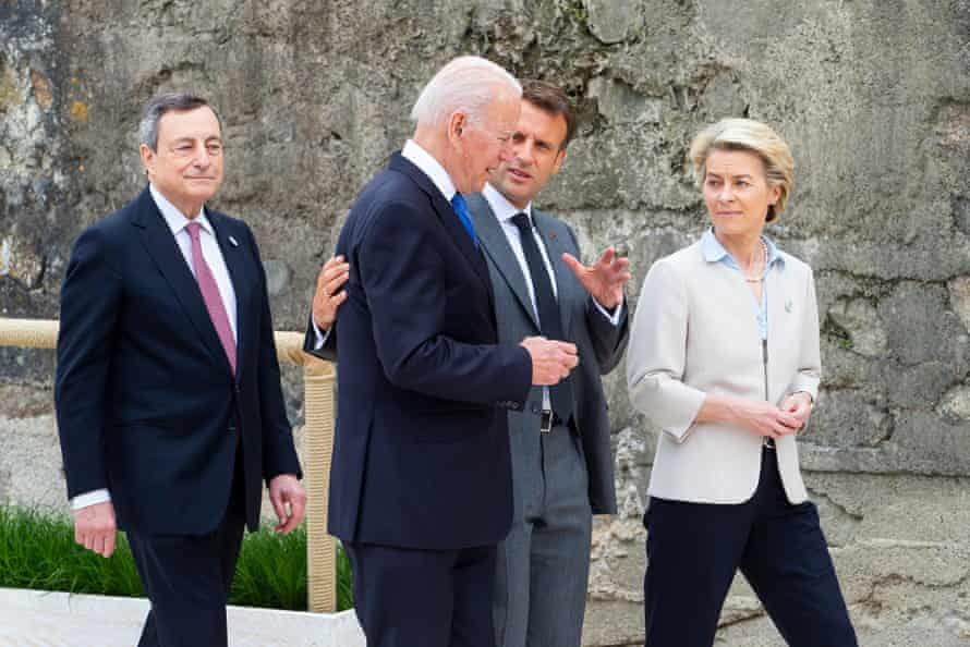 Joe Biden in deep discussion with Emmanuel Macron as they leave the event.