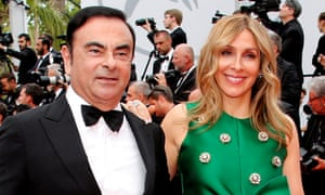 Carole Ghosn, pictured with her husband Carlos Ghosn, says he was being detained in 'dehumanising' conditions.