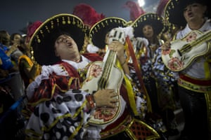Singers from the Academicos do Grande Rio samba school perform