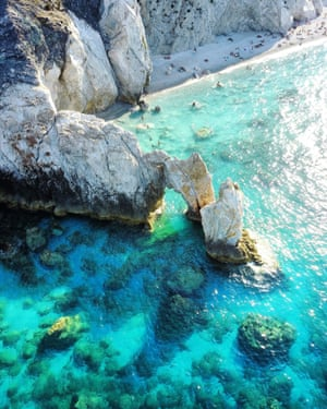 Drone image of Lalaria beach in Skiathos. Lalaria beach in Skiathos is one of the most beautiful beaches in Greece, and in the Mediterranean. At the north-east end of the island, it is only accessible by sea, and only when the weather permits because the beach is exposed to northerly winds and the waves get high when the weather is bad. On the edge of the beach is the beautiful stone arch of 'Tripia Petra' (Hole Stone). The beach is swept away many times by the waves in winter … until the weather settles down again and it takes on a new shape and form.