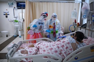 Clowns entertain a Covid-19 patient in the intensive care ward for coronavirus patients at Shaare Zedek medical centre.