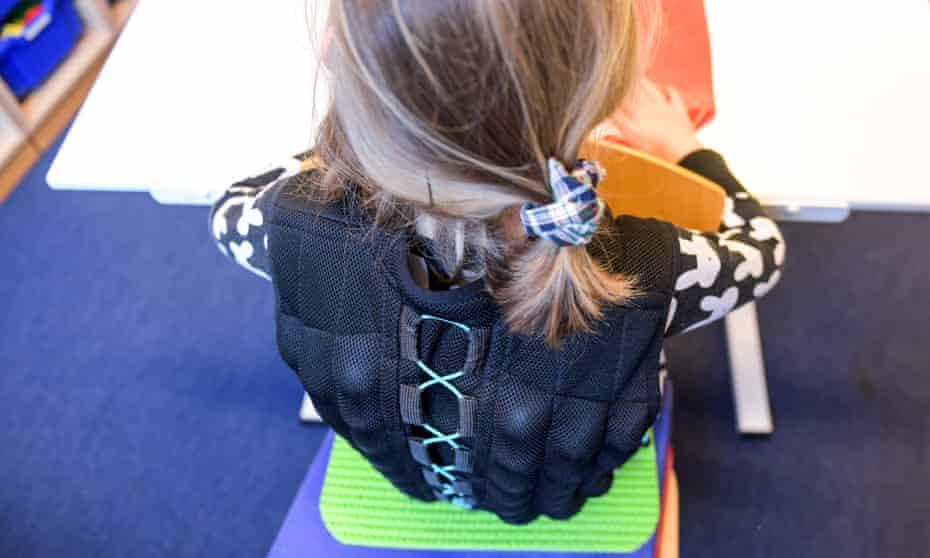 Nine-year-old Nina wears a sand-filled vest at school in Hamburg.