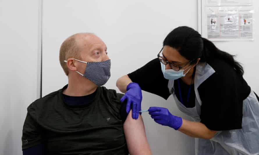 Martin Gillibrand receives an AstraZeneca vaccination in the City of London.
