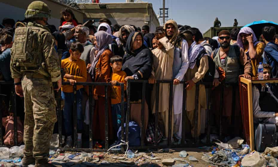 Afghans attempt to leave the country via Kabul airport; the UN estimates 500,000 will try to flee.