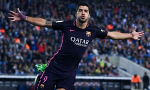 Luis Suárez celebrates after scoring the opening goal for Barcelona