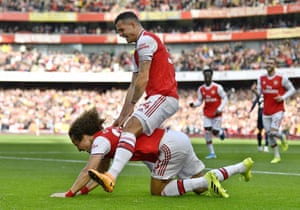 Granit Xhaxa helps David Luiz celebrate his goal against Bournemouth. Ten of Luiz's 12 Premier League goals have been scored in home matches, with this his first goal for Arsenal.