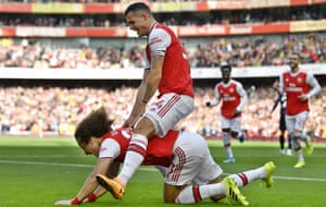 Granit Xhaxa takes a ride on David Luiz after the Brazilian put Arsenal 1-0 up against Bournemouth