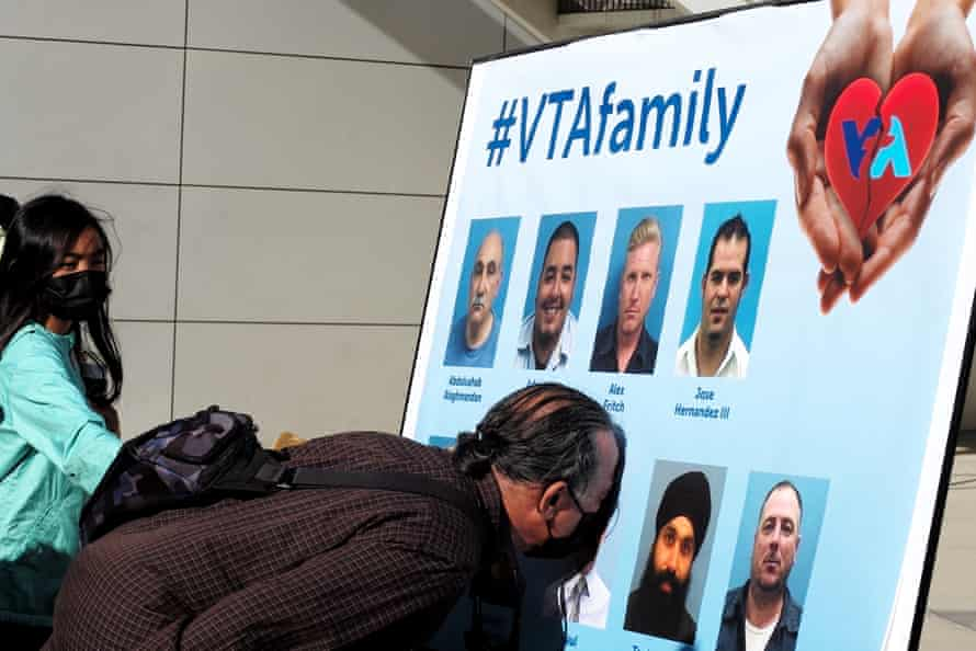 Relatives mourn for victims of a mass shooting in San Jose.
