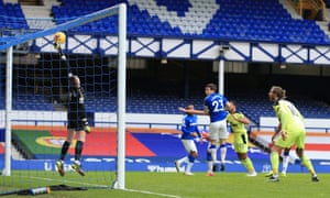 Everton goalkeeper Jordan Pickford saves a header from Callum Wilson of Newcastle United.