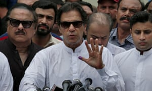 Imran Khan speaks to media after casting his vote at a polling station in Islamabad.