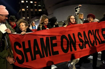 Photographer Nan Goldin leads a protest out of the Guggenheim Museum in Manhattan, New York, against its funding by the Sackler family, the owners of Oxycontin manufacturer Purdue.