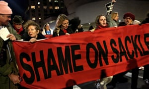 People protest against the Sackler family outside the Guggenheim museum in New York on 9 February. The museum has said it will not accept any donations from the family.