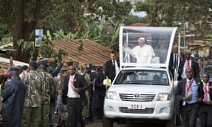 Pope Francis waves to residents in Kangemi