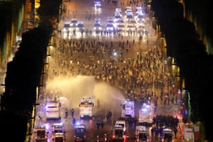 Riot police uses water cannon to disperse people on the Champs-Élysées