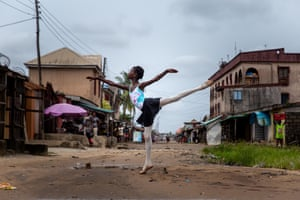 A student of the Leap of Dance academy, Precious Duru, performs in Okelola street in Ajangbadi