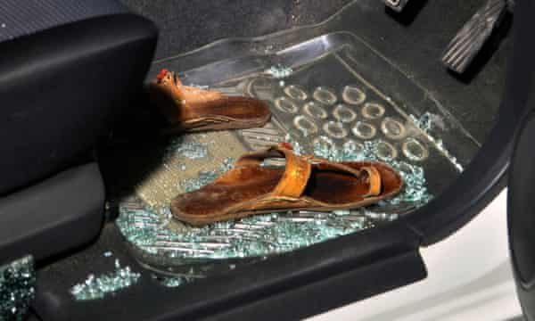 Sabeen Mahmud's sandals lie on the floor of the car after she was shot dead.