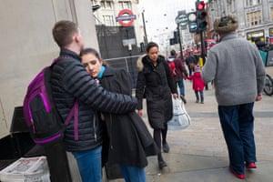A couple embrace near Oxford Circus tube station