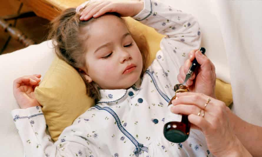 An ill child receives medicine
