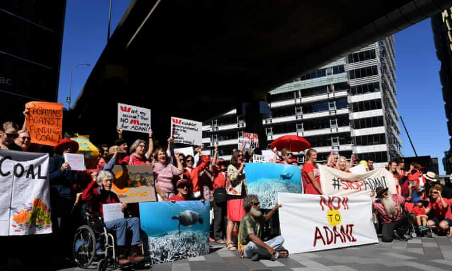 Protesters assemble at the Westpac Bank headquarters in Sydney in February to call on the bank to rule out funding for Adani's Carmichael coalmine in northern Queensland.
