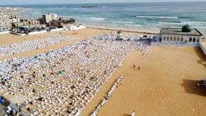 Dakar, SenegalMuslims from the Layene Brotherhood, a religious sect of Sufi Muslims, attend Eid-al-Adha prayers