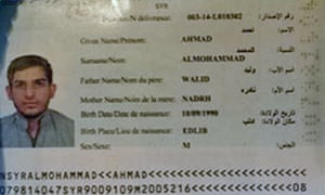 The Syrian passport of Paris bomber Ahmad Almohammad. A man carrying a passport with the same name and details but a different photo has been arrested in Serbia.