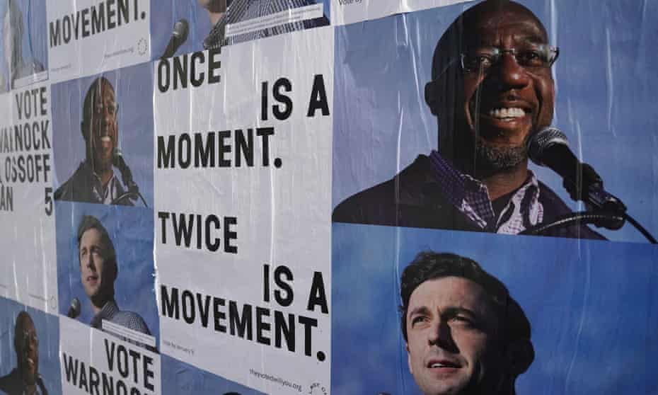 Campaign ads for Jon Ossoff and Raphael Warnock are seen on a wall near the John Lewis mural the day after the US Senate runoff elections in Atlanta, Georgia.