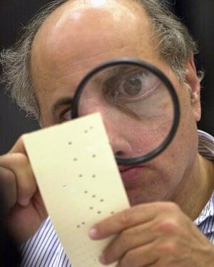 In 2000, a Broward county canvassing board member, Judge Robert Rosenberg, examines a ballot.