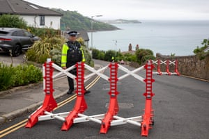 Police staff a checkpoint at Carbis Bay