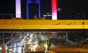 Turkish soldiers block the Bosporus Bridge in Istanbul preventing cars leaving the Asian side of the river.