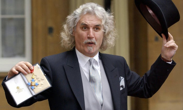 Billy Connolly shows off his CBE