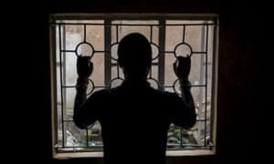 Man behind bars in silhouette