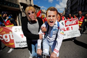 Marseille, France Demonstrators wear masks depicting the centrist presidential candidate Emmanuel Macron and his wife Brigitte
